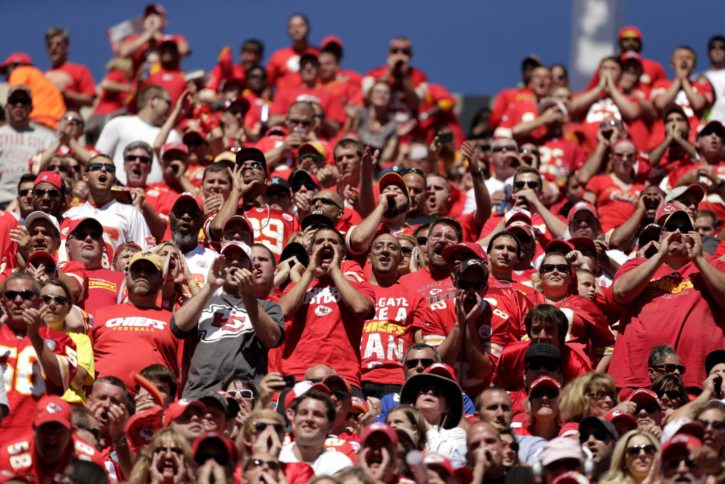 Kansas City Chiefs fans cheer during the second half of an NFL football game against the New York Giants at Arrowhead Stadium in Kansas City, Mo., Sunday, Sept. 29, 2013. (AP Photo/Charlie Riedel)
